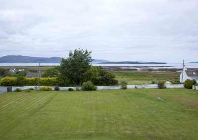 View from bedroom - garden and Broadford Bay