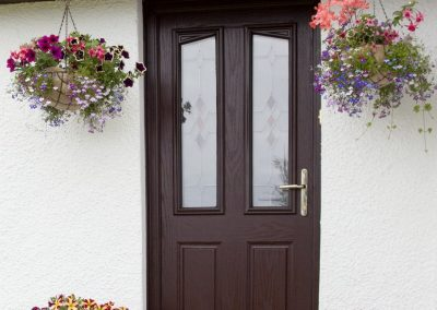 Front door with hanging flower baskets